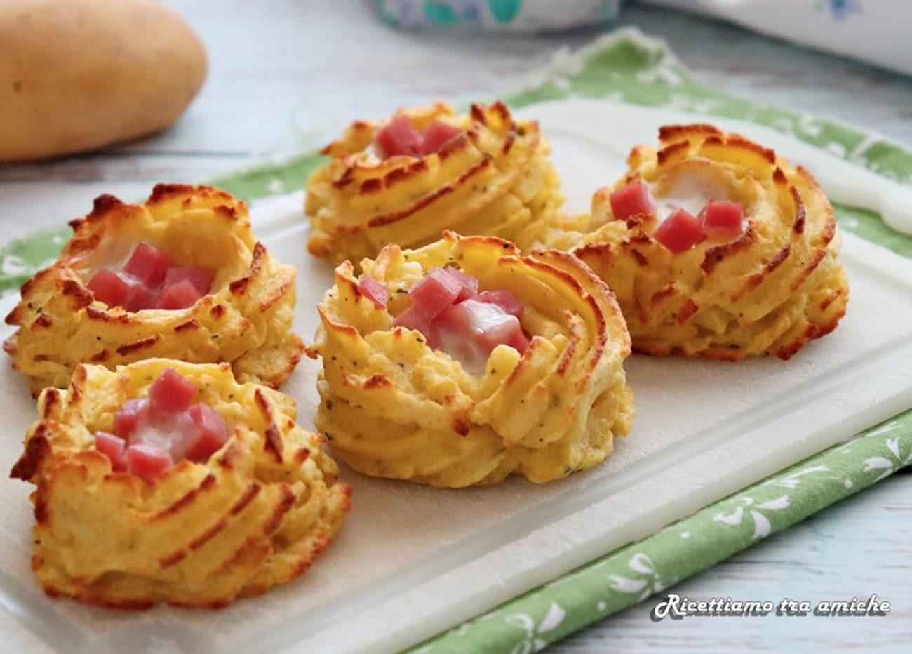 Nidi di patate con prosciutto cotto e mozzarella