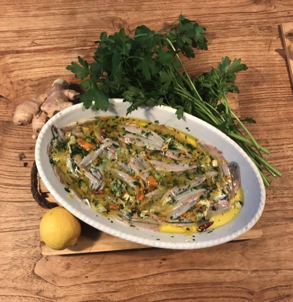 Alici marinate con salsa di limone, arancia e zenzero